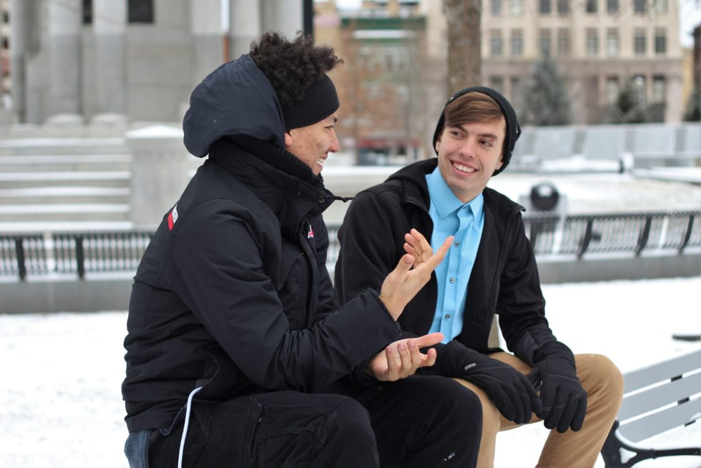 two young men having a mentoring conversation