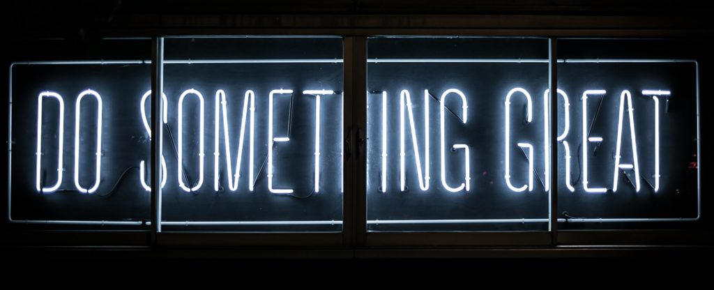 neon sign - do something great - mentor global development professionals