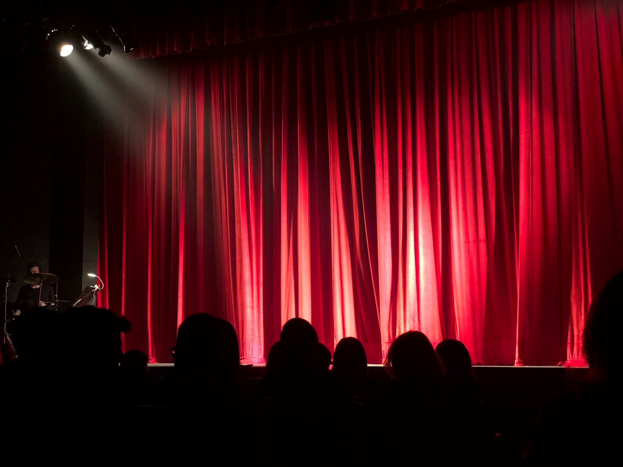 Red curtains in a theatre - Practice your elevator pitch - important skill for global development professionals