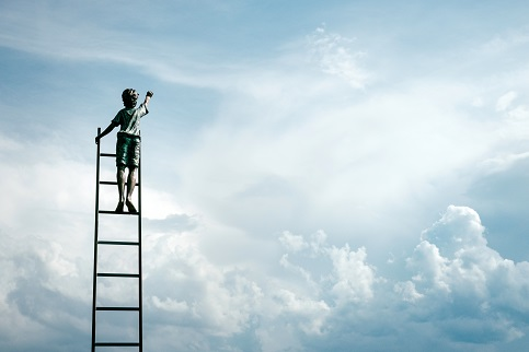Small boy on ladder reaching for the sky - Celebrate acts of kindness - World Kindness Day - move forward