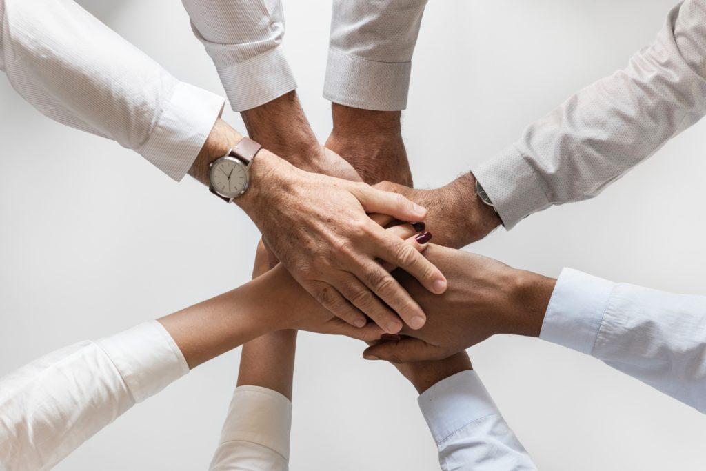 professionals hands together