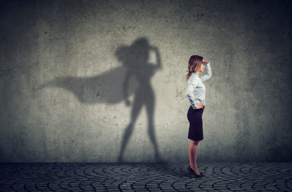 woman self-reflecting superhero shadow